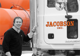 Vice president Lorin Jacobson poses with concrete / cement mixer truck in Pauls Valley Oklahoma
